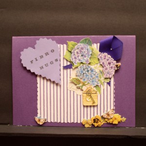 Tell a FIbromite you care with a beautiful, handmade, custom card, that includes a purple ribbon. The inside is blank for you to write an uplifting message.